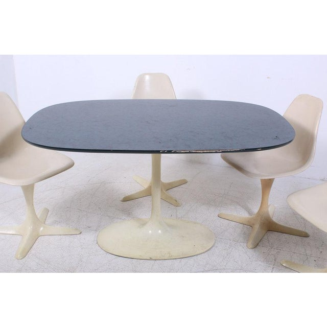 Lovely set of 4 Saarineen style Burke Star Trek chairs with the matching Burke Tulip table. This vintage set is clean and...