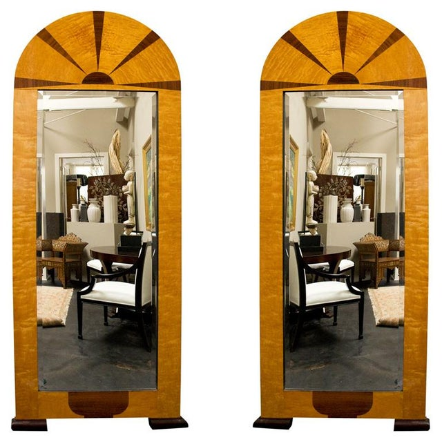 Pair of Swedish art deco mirrors in birch wood with inlaid rosewood sunbursts, molded bracket feet.