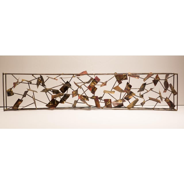 Hand collaged sculpture consisting of multiple acid-washed metal panels attached to thin metal rods, set into an open...