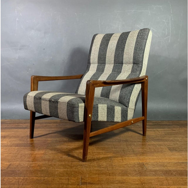 Classic Scandinavian modern tradition - a perfect lounge chair with a striped wool fabric over solid walnut frame....