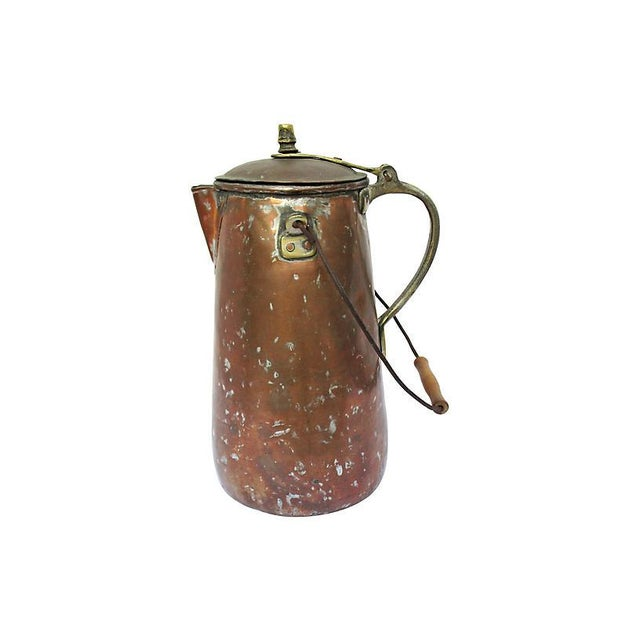 Large 19th-century hand-forged copper coffeepot. Natural time-worn patina throughout. Age wear.