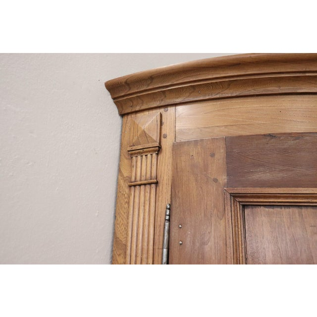 Italian corner cupboard from the 19th century. High quality furniture in solid chestnut. Particular round front door. on...