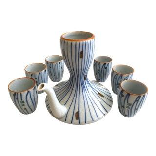 Vintage Mid Century Modernist Japan Indigo Blue Stripe Craquelure Ceramic Sake Carafe & Cups - Set of 8 For Sale