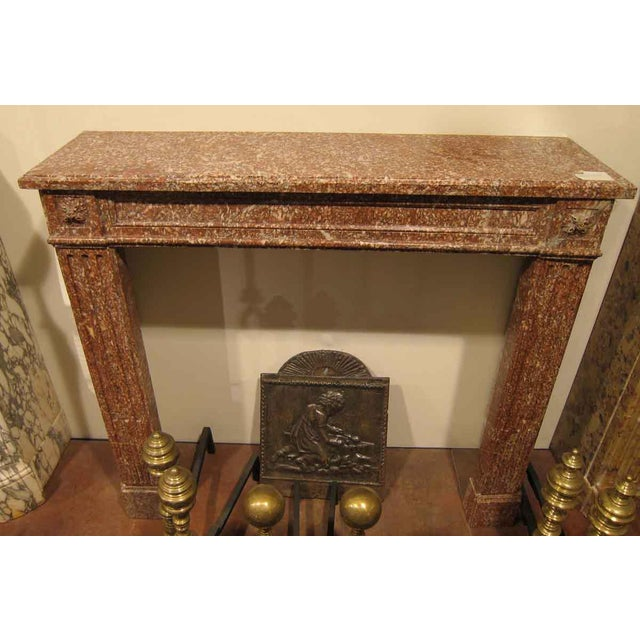 Late 19th century louis xvi mantel with a unique pink color. This is one of several additions from danny alessandro &...