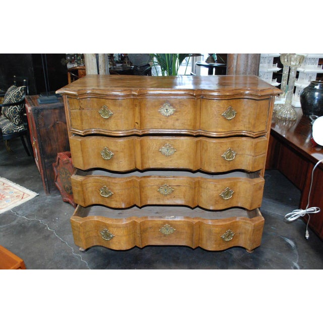Serpentine Danish Oak Chest of Drawers Features four large drawers with original hardware.