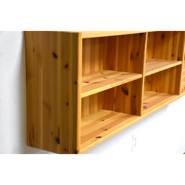 """A modern solid pine bookcase cabinet hanging shelf made in a Denmark by Idé Møbler. 75.875"""" wide. 9.75"""" deep. 21"""" tall."""