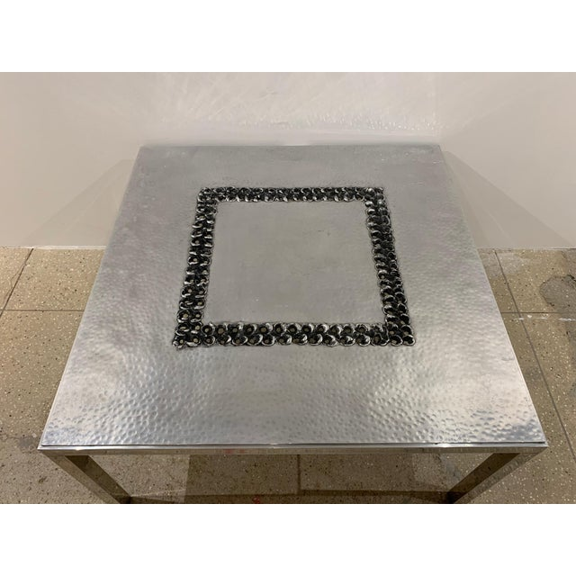 A handmade hammered and burnished aluminum coffee table by Belgian artist, Willy Luyckx for Aluclair. Willy Luyckx was a...
