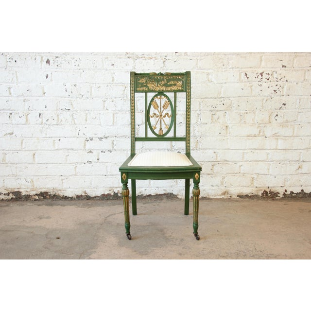 Offering a gorgeous early 20th century hand-carved and hand-painted Italian accent chair. The chair features stunning...