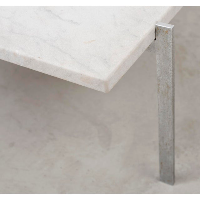 PK 61 coffee table by Poul Kjærholm in white marble with a subtle bush hammered finish. Frame in matte chrome-plated...