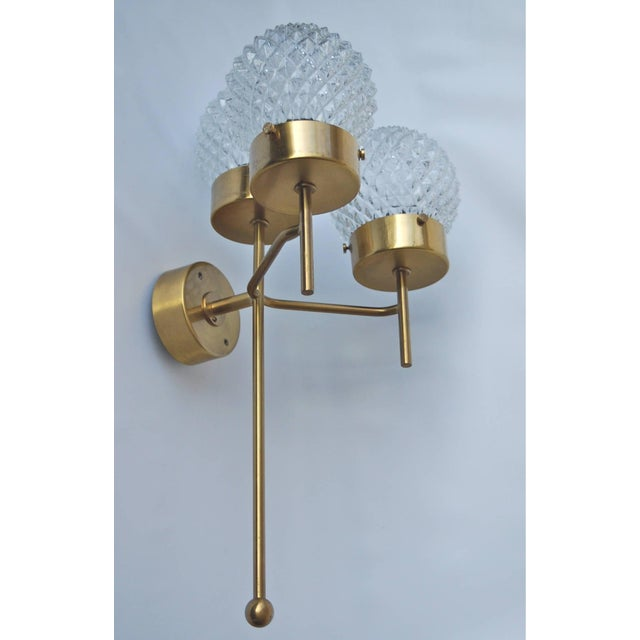 Large and rare pair of wall lights by Hans-Agne Jakobsson for Markaryd, Sweden, circa 1960s. Brass and textured glass....