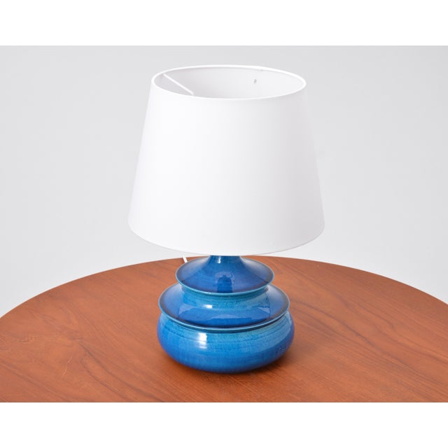 This circular table lamp was designed by Nils Kähler in the 1960s in Denmark and produced by the company HA Kähler. It is...