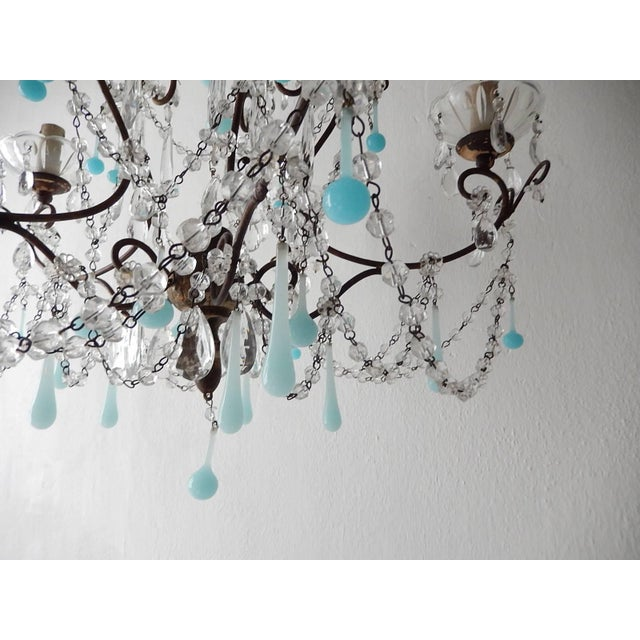 Housing five lights, sitting in crystal bobeches dripping with vintage crystals. Rewired and ready to hang. Chippy...