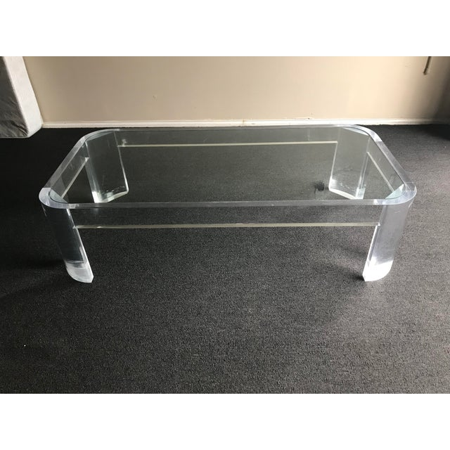 Attractive and massive lucite and glass coffee table. Likely designed by the great Palm Springs designer Steve Chase. The...