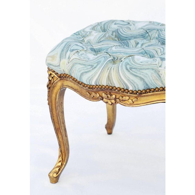 Stool, in the Louis XV style, having a tufted rectangular seat, upholstered, on fielded frame, carved with florals,...