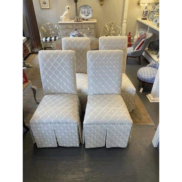 Parsons slipper chairs with a new gray and white fabric newly reupholstered