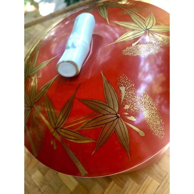 What bento box! Very collectible Jubako stackable bowls. Hand painted detailing with Gilt bamboo motifs throughout. No...