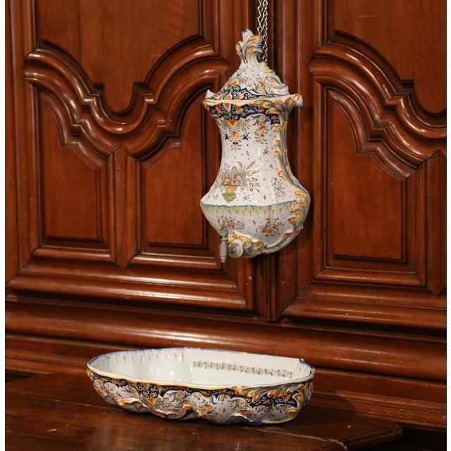 Decorate a wall with this antique ceramic fountain from Normandy. Crafted in Rouen, France, circa 1890, the decorative...