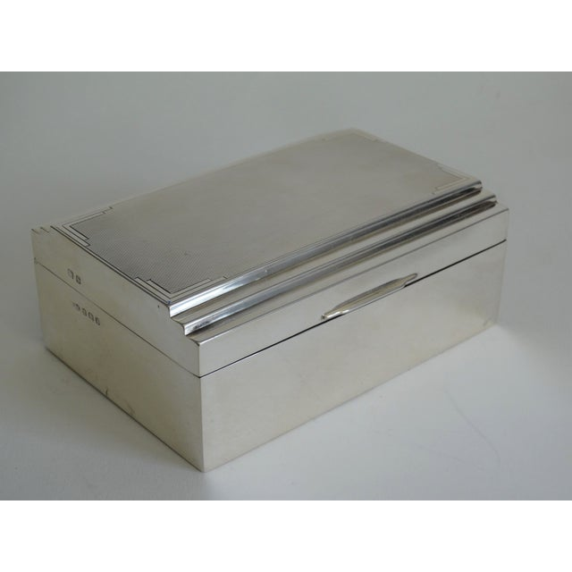 English Art Deco sterling silver table box. It has a stepped, engine turned decorative lid and fitted interior. Hallmarked...