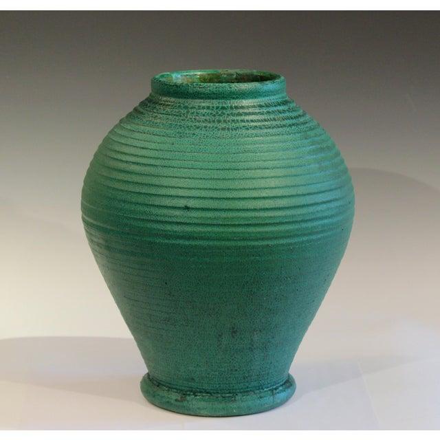 Huge antique Merrimac Pottery Arts & Crafts vase with fantastic alligatored matte green glaze. Merrimac Pottery operated...