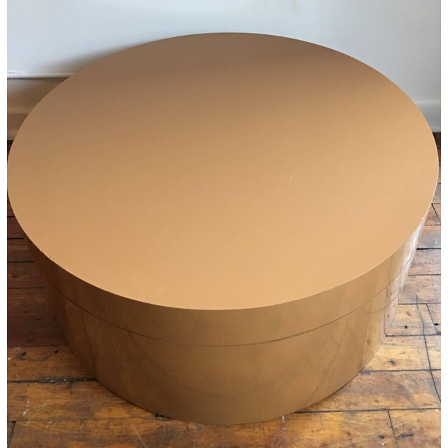 Large round Mid-Century Modern two-tier swivel cocktail table. Top tier can be expanded to reveal two circular tops or...