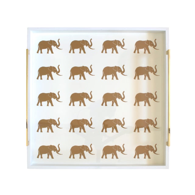 The elephants are on parade on our highly polished ivory lacquer Meru tray. Polished cast brass handles are set at either...