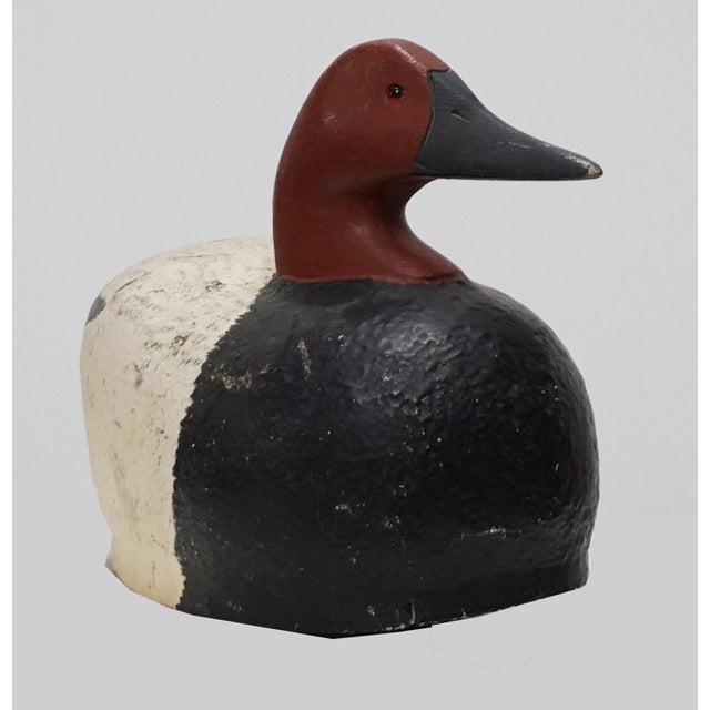 Handcrafted vintage solid wood red head duck decoy. There are chips and age on body and bottom. C. E. Fisher printed on...