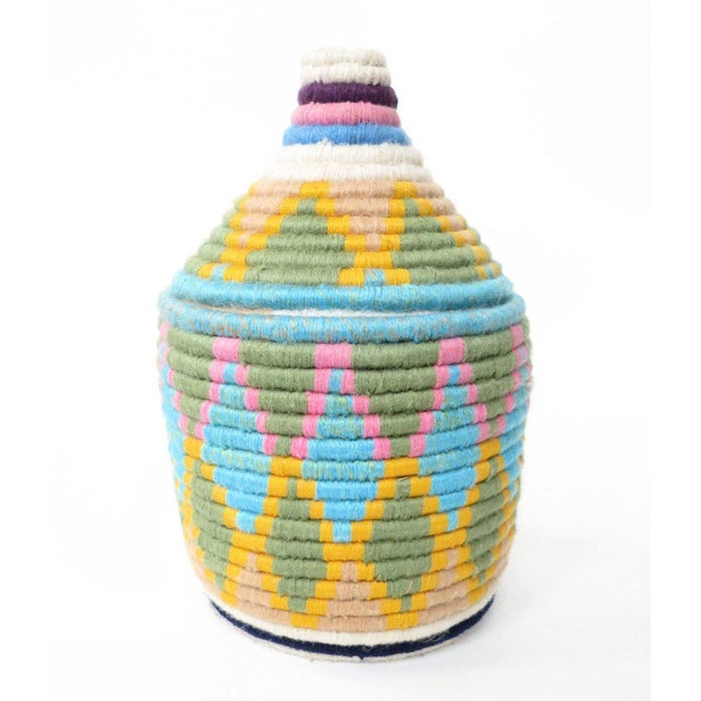Hand woven cotton thread lidded baskets, traditionally used to store traditional round bread know as 'hubs.' All one of a...