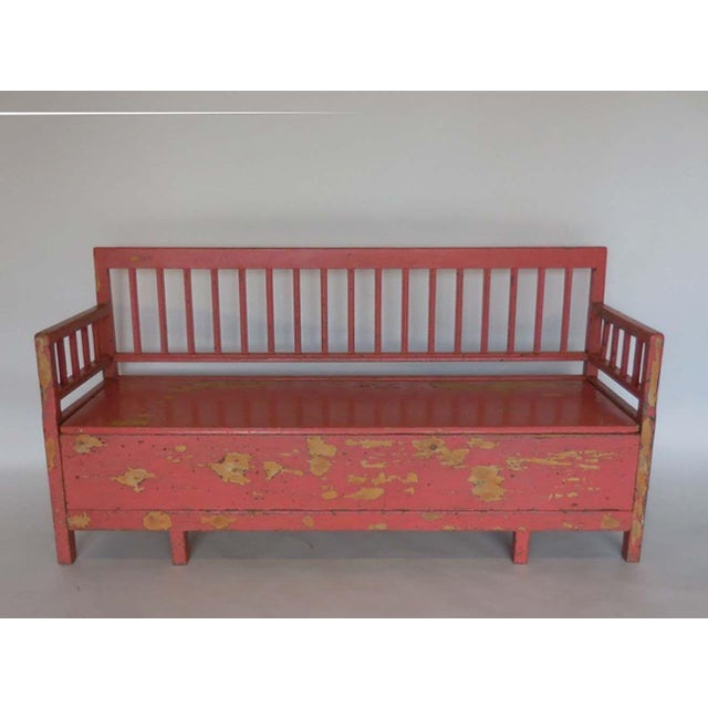 Swedish painted koks soffa/bench (kitchen sofa) used as a bench in a farm kitchen as well as a pull-out bed for the house...