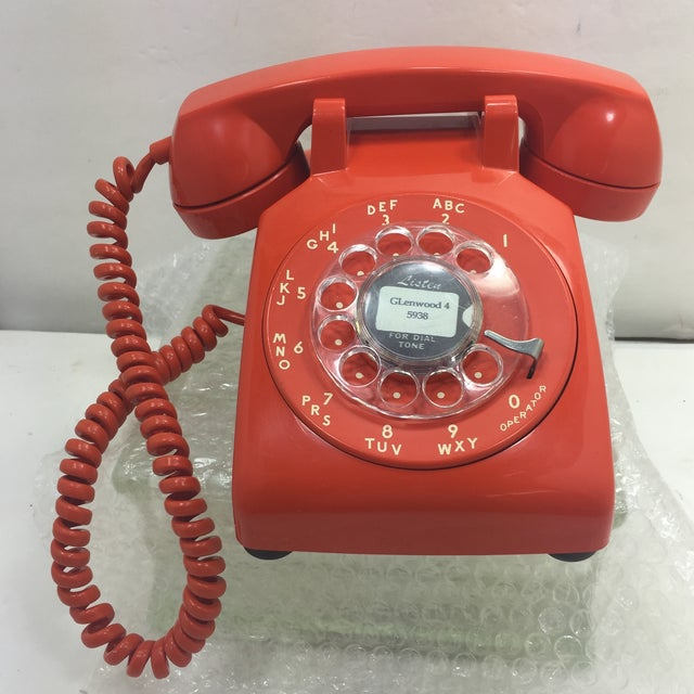 Vintage Stromberg Carlson orange rotary dial phone. 1975 called and they  want their phone back