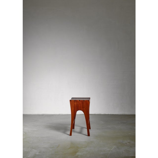 A studio crafted stool or side table by Californian furniture designer and craftsman John Nyquist (1936). The stool has a...