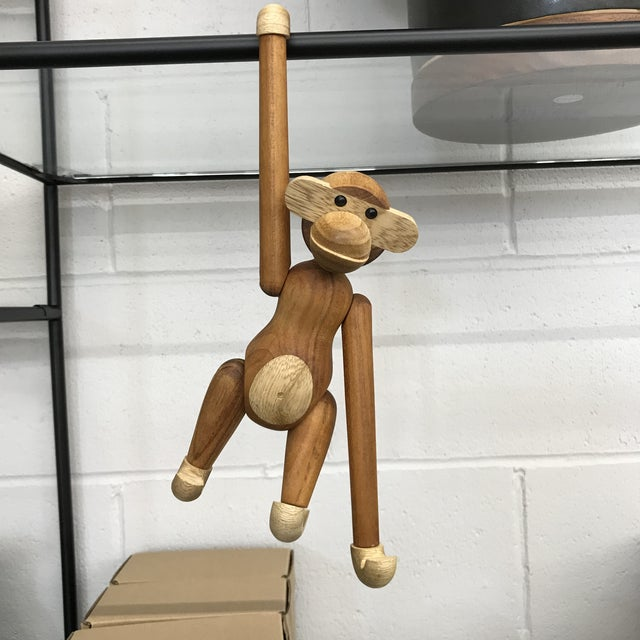 Danish modern handmade wooden teak monkey designed by Kay Bojesen and made in Denmark. He can sit, lay, or hang from...