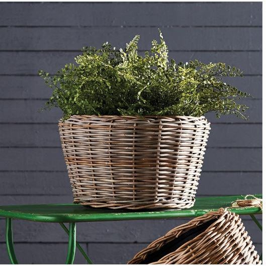Here's a smart idea- a new rattan planter tightly woven around grower's pots. The plastic pot helps the weave retain shape...