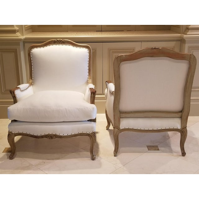 Beautifully carved 19th C Louis XV Bergeres . All new upholstery in Sateen Cotton. Tight Seat Back has the original...