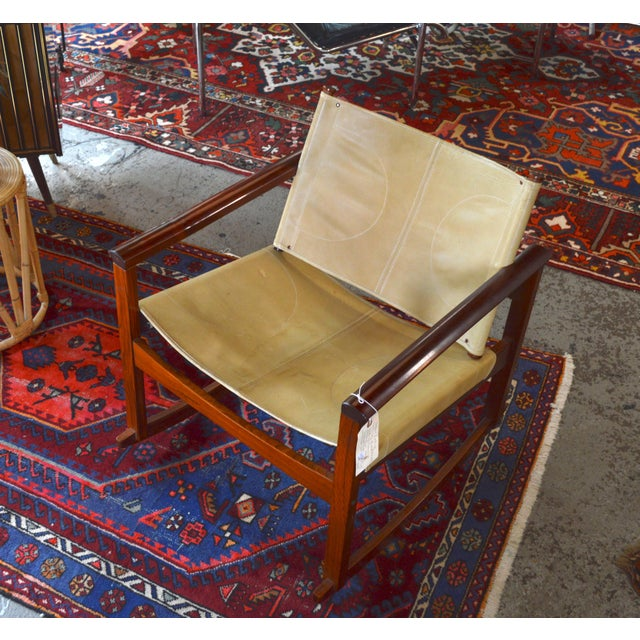 Classic mid century PegLev rocking chair by Michel Arnoult. Made in France, circa 1960. Beautiful rosewood frame with...
