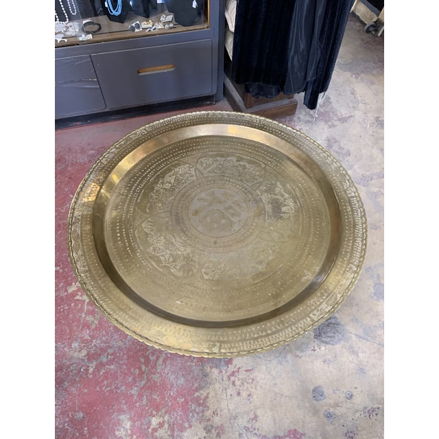 Versatile! Top can hang on the wall, and table folds up to store in the closet. Perfect for company. Round Moroccan brass...