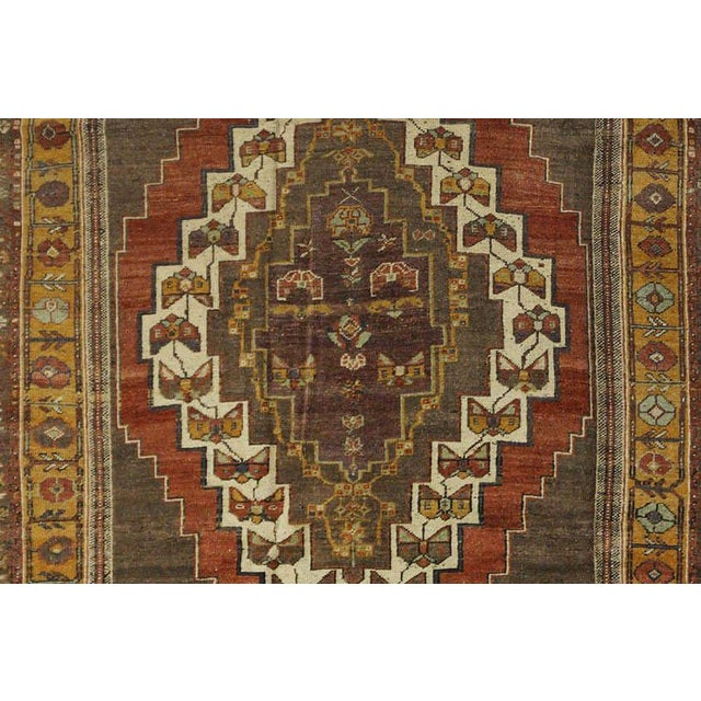 This beautiful vintage Turkish Oushak rug is hand-knotted, 100% wool, made in Turkey, Ushak region. It features a pattern...