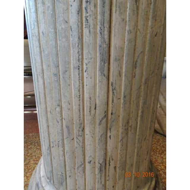 Fluted wood column with round carving at the bottom on a square base. Painted in cream and gray as a faux marble finish....