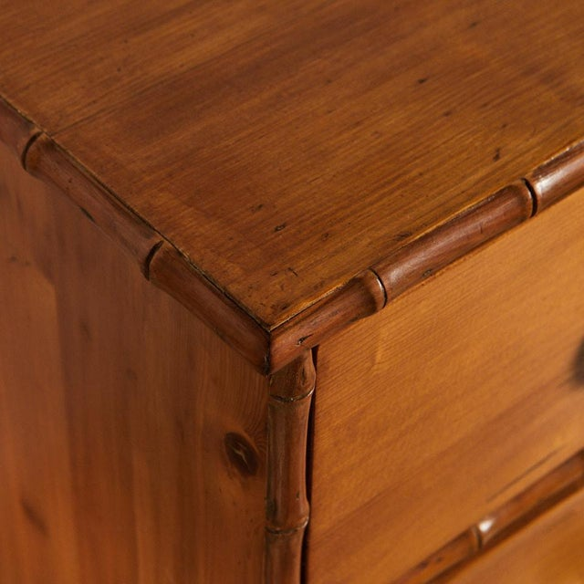 This attractive french pine chest of drawers has delicate faux bamboo details along the edges and drawers.. The knobs are...