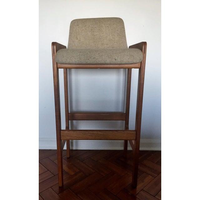 Wonderful Danish modern teak bar stool by D-Scan. Iconic mid century modern style similar to Danish designer Tarm Stole....