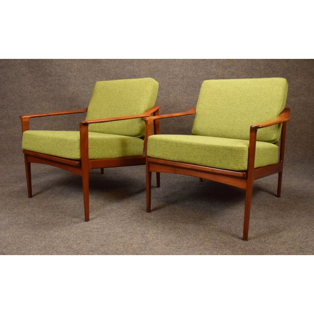 Here is a pair of sculptural mid century easy chairs in teak wood manufactured in Germany in the 1960's. This beauties,...