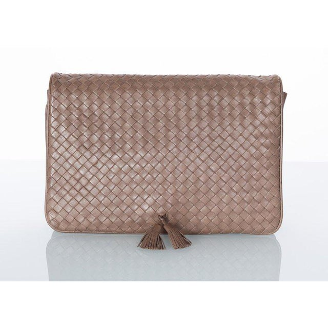 First introduced in the 1960s, the intrecciato (technique of weaving the leather) weave style became the iconic hallmark...