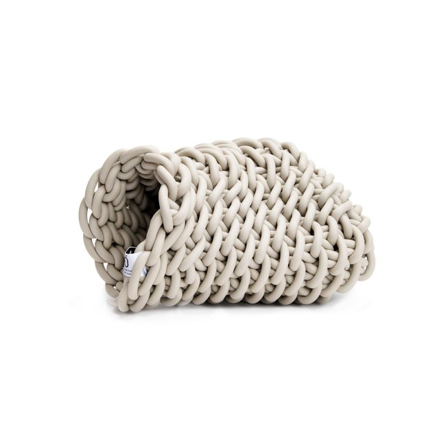 Barca Basket By Neo Hand-knitted in Italy, this ecru colored neoprene basket is designed by Rosanna Contadini. Neoprene is...