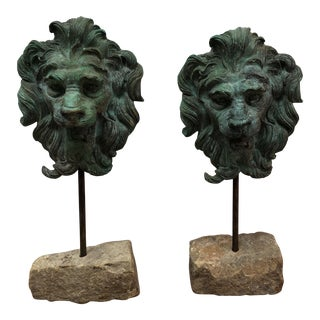 Patinated Bronze Lions on Stone Bases - A Pair