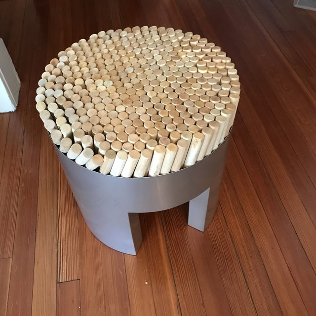 The Chiquita Stool is constructed of rattan poles that sit upon a polyurethane cushion. Poles sink softly when sat upon....