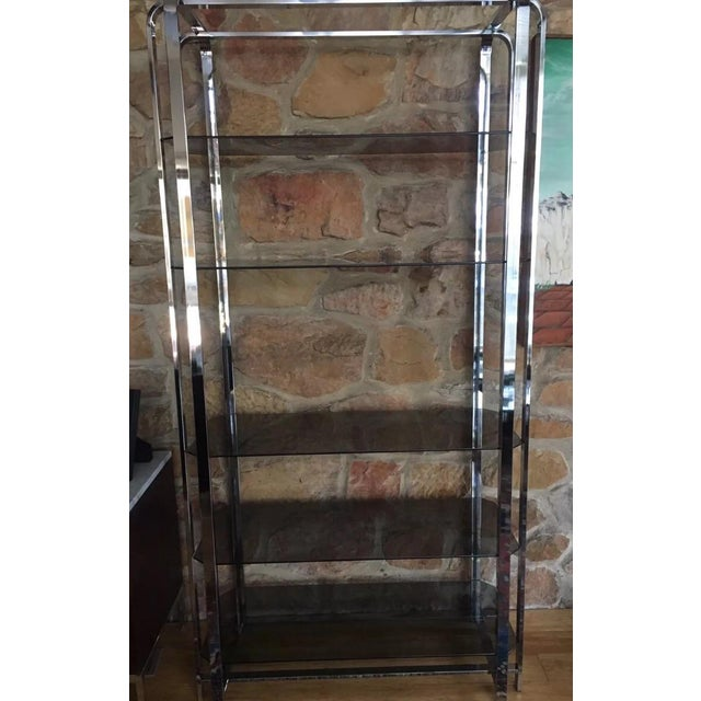 This is a beautiful original Milo Baughman Mid-Century Modern Glass shelving unit which is in excellent condition. All...