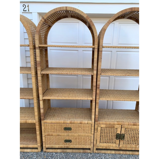 Amazing set of 3 Vintage Rattan Pieces. Each has 3 upper shelves, one has two drawers and the other has a cabinet....