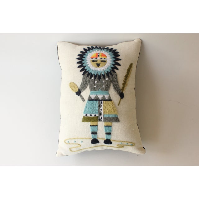 This pillow was upcycled from a vintage crewel embroidery. The backing material of the pillow is new, black corduroy...