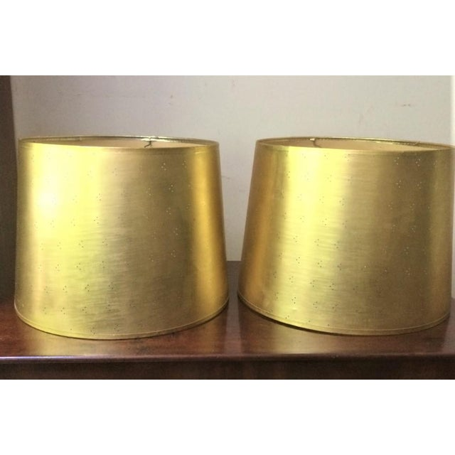 Glamorous shades that are pure fun. Gold-toned paper drum shades (very slight angle to the drum) perforated with tiny...