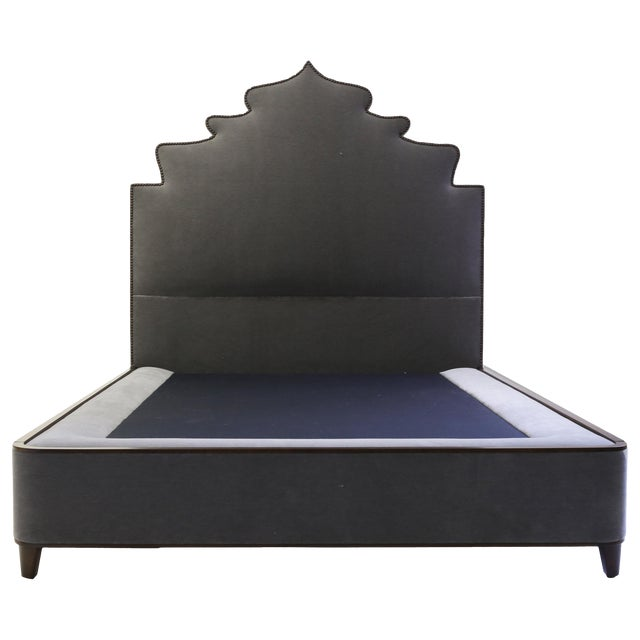 Queensize Bed With Carved Headboard With Nailheads and Covered Base on Wood Legs For Sale
