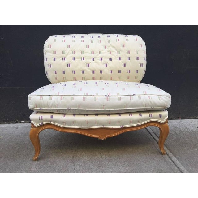 Louis XIV style French loveseat. Frame is walnut and has loose cushions.